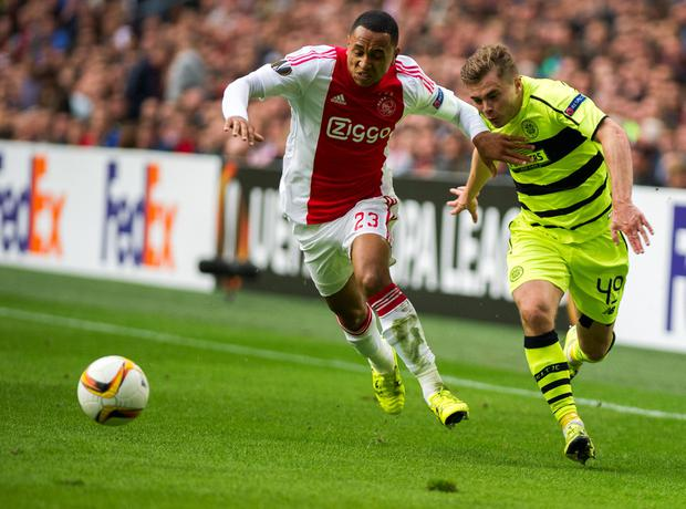 Ajax's Kenny Tete and Celtic's James Forrest vie for the ball during the Europe League Group A soccer match between Ajax Amsterdam and Celtic Glasgow, at the ArenA stadium in Amsterdam, Netherlands, Thursday, Sept. 17, 2015. (AP Photo/Patrick Post)