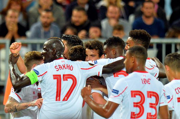 Liverpool's players celebrate after scoring the opening goal during the UEFA Europa League Group B football match Bordeaux vs Liverpool on September 17, 2015 at the Matmut Atlantique stadium in Bordeaux. AFP/Getty Images
