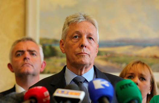 First Minister Peter Robinson (pictured) is considering legal action against independent TD Mick Wallace over comments posted on Twitter