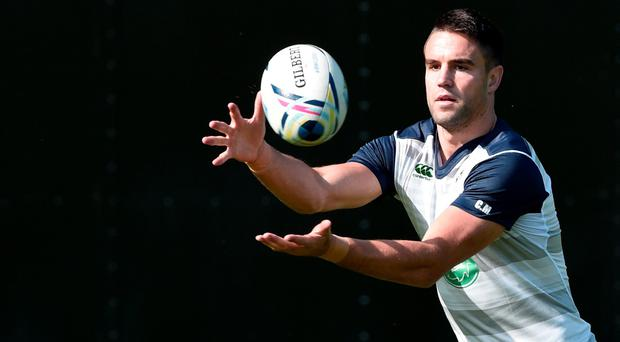 Ireland's scrum half Conor Murray catches a ball during a team training session in Cardiff