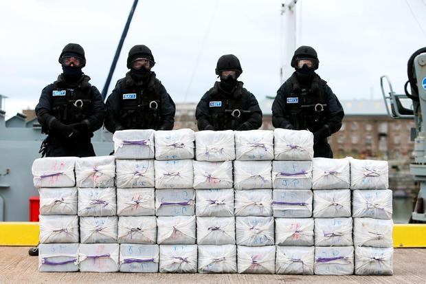 Members of the Irish Navy with stacks of cocaine taken from the yacht Makayabella in Haulbowline naval base, Cobh, Co Cork. Photo: Brian Lawless/PA