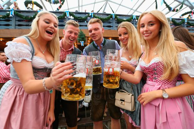 Revelers raise their beer glasses at the Schottenhamel beer tent on the opening day of the 2015 Oktoberfest on September 19, 2015 in Munich, Germany. The 182nd Oktoberfest will be open to the public from September 19 through October 4 and will draw millions of visitors from across the globe in the world's largest beer fest. (Photo by Alexander Hassenstein/Getty Images)
