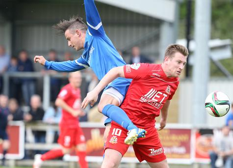 Portadown's Mark McAllister in action (right)