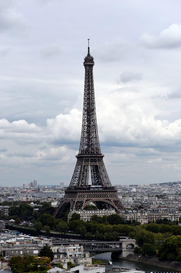 The Eiffel Tower was closed to the public on Sunday morning following an intrusion attempt. AFP PHOTO/Miguel Medina/Getty Images.