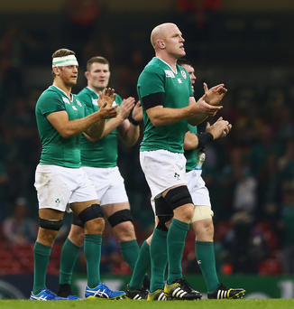 Fan power: Ireland captain Paul O'Connell leads his team off the field as they pay tribute to fans in Cardiff