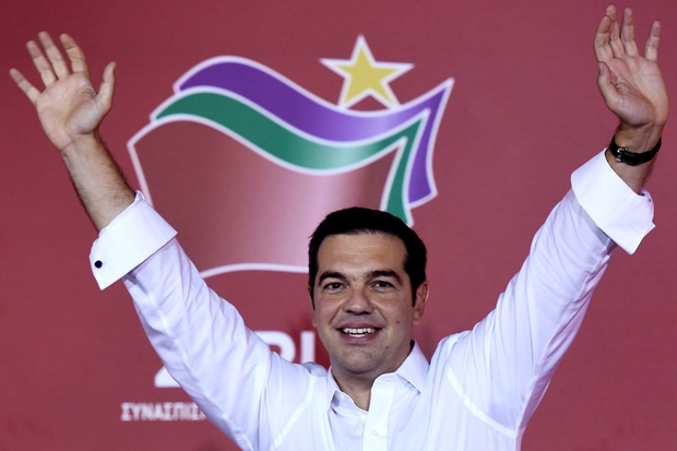 Leader of the Greek radical-left Syriza party Alexis Tsipras waves to supporters as he arrives at the main party's election headquarters in central Athens on September 20, 2015. Greek conservative leader Vangelis Meimarakis on Sunday conceded defeat in a general election that returned leftwing Alexis Tsipras to power. With more than a third of the vote counted, Tsipras' Syriza party was on 35.46 percent to New Democracy's 28.26 percent. AFP PHOTO / ARIS MESSINISARIS MESSINIS/AFP/Getty Images