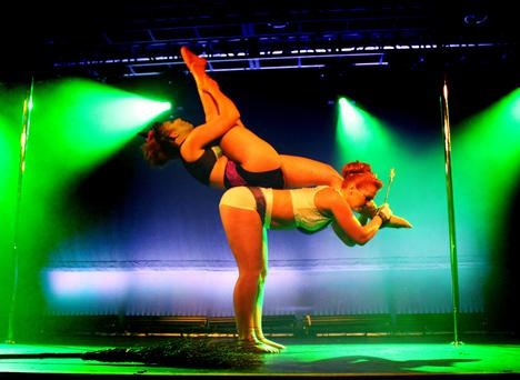 Seanin Ward (bottom) and Emma White (top) 2015 All Ireland Pole Dancing champions for the doubles division. Pic Valerie M. Edwards