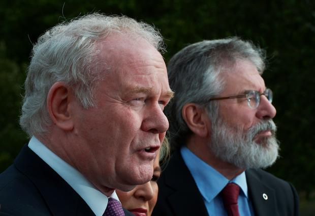 Northern Ireland Deputy First Minister Martin McGuinness (L) and Sinn Fein President Gerry Adams (R) speak to the gathered media at a press conference at Stormont on September 21, 2015 in Belfast, Northern Ireland. (Photo by Charles McQuillan/Getty Images)