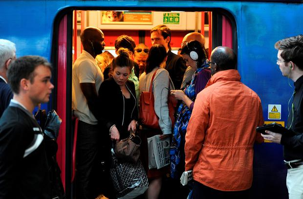 Commuters making their way off a train. (Andrew Matthews/PA Wire)