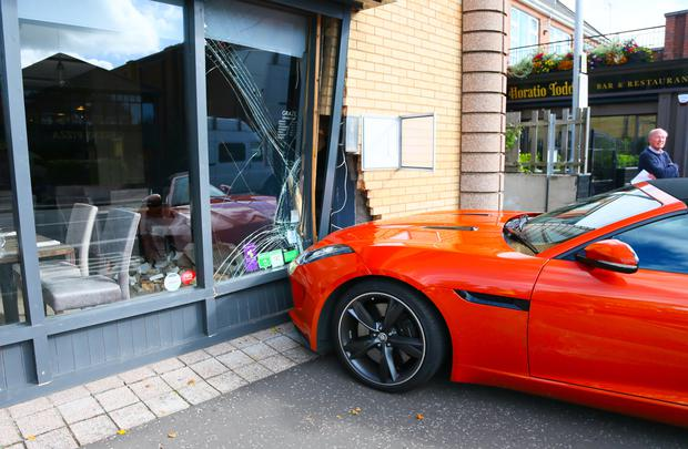Pictured is a £60,000 sports car collided into a restaurant window on the Upper Newtownards road in Belfast. Police attend the scene. Picture - Kevin Scott / Presseye