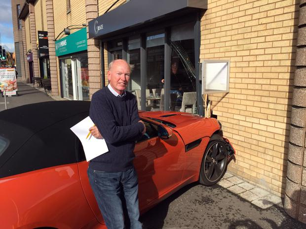 Sam Butler pictured with his 86K Jaguar F type sports car