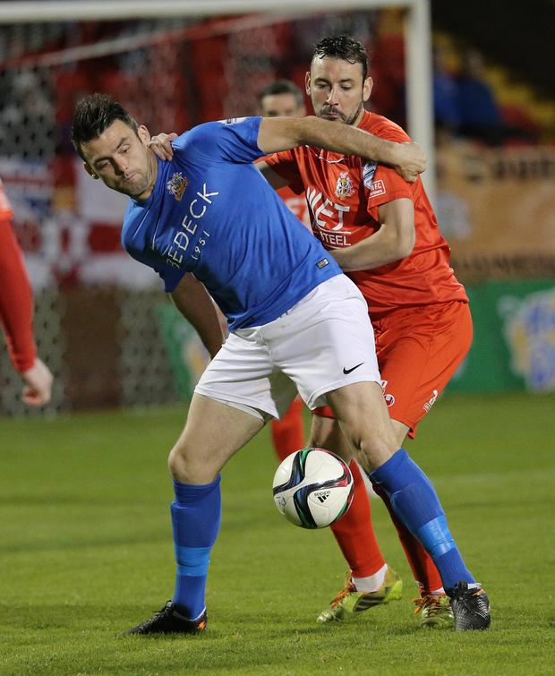 Pacemaker Belfast 22-09-2015 Portadown v Glenavon - Danske Bank Premiership Portadown's Michael Gault and Glenavon's Eoin Bradley during tonight's game at Shamrock Park, Portadown. Photo by David Maginnis/Pacemaker Press