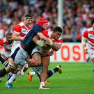 Amanaki Mafi of Japan is tackled by Grant Gilchrist of Scotland during the 2015 Rugby World Cup Pool B match between Scotland and Japan at Kingsholm Stadium on September 23, 2015 in Gloucester, United Kingdom. (Photo by Ben Hoskins/Getty Images)