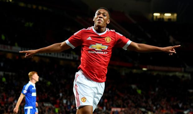 Manchester United's Anthony Martial celebrates scoring his team's third goal of the game during the Capital One Cup, third round match at Old Trafford, Manchester.