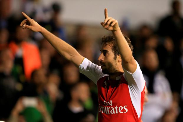 Arsenal's Mathieu Flamini celebrates scoring his side's second goal of the game during the Capital One Cup, third round match at White Hart Lane, London. Photo: PA