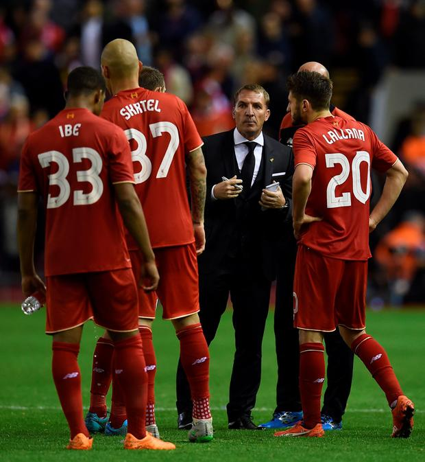Liverpool's Northern Irish manager Brendan Rodgers (3rd R) decides the penalties order after the English League Cup third round football match between Liverpool and Carlisle United at Anfield in Liverpool, north west England on September 23, 2015.