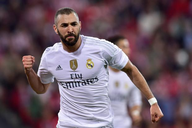 Real Madrid's Karim Benzema of France, celebrates after scoring against Athletic Bilbao, during their Spanish La Liga soccer match, at San Mames stadium in Bilbao, northern Spain, Wednesday, Sept. 23, 2015. (AP Photo/Alvaro Barrientos)