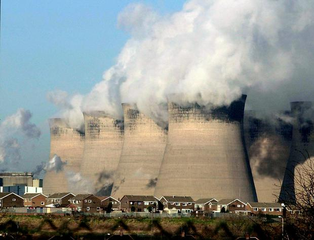 Cooling towers for a coal fired power station, as analysis suggests that UK councils have invested £14 billion of pension funds in fossil fuels, an average of £218 per resident across the country. (John Giles/PA Wire)