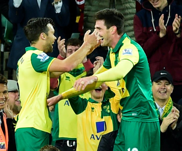 Canary crazy: Kyle Lafferty (right) celebrates scoring for Norwich in the 3-0 Capital Cup win over West Brom