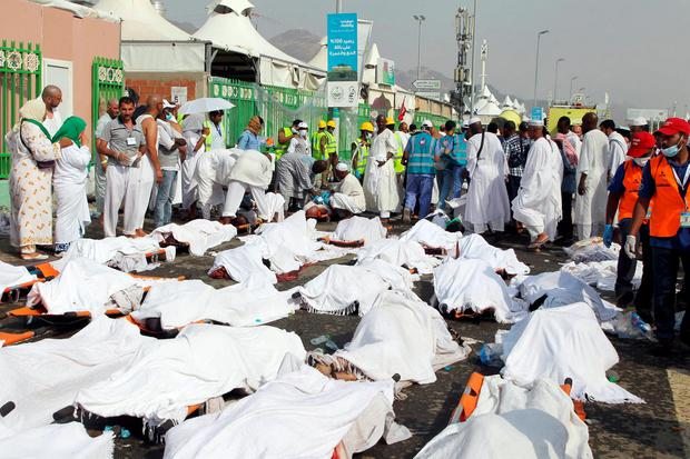 Saudi emergency personnel stand near bodies of Hajj pilgrims at the site where at least 717 were killed and hundreds wounded in a stampede in Mina, near the holy city of Mecca, at the annual hajj in Saudi Arabia on September 24, 2015. AFP/Getty Images