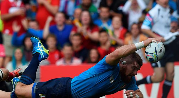 Italy's prop Michele Rizzo scores a try during a Pool D match of the 2015 Rugby World Cup between Italy and Canada at Elland Road in Leeds. AFP PHOTO / PAUL ELLIS