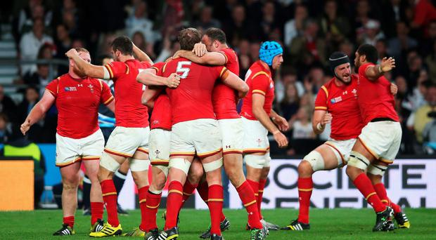 The Wales team celebrate victory on the final whistle during the 2015 Rugby World Cup Pool A match between England and Wales at Twickenham. Photo by David Rogers/Getty Images