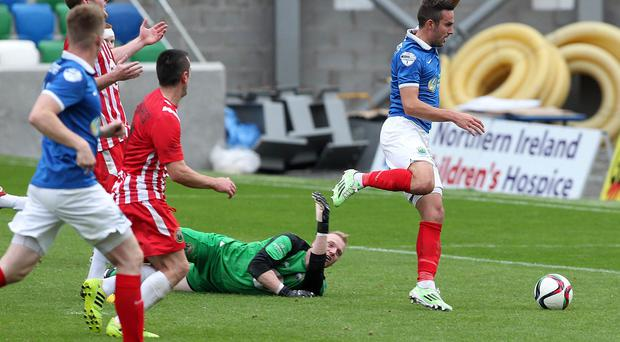 Linfield's Andrew Waterworth goes past Warrenpoint Town goalkeeper Aaron Shananan for his fourth goal