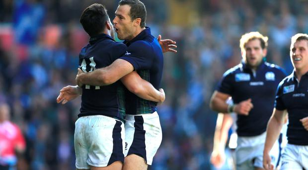 Scotland's Sean Maitland (left) celebrates with Tim Visser after scoring his sides second try of the game against USA during the Rugby World Cup match at Elland Road, Leeds. Nigel French/PA Wire.