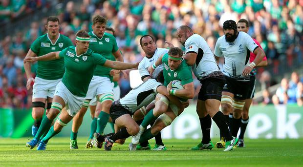 Ireland's Jamie Heaslip is tackled during the Rugby World Cup match at Wembley Stadium, London. David Davies/PA Wire.