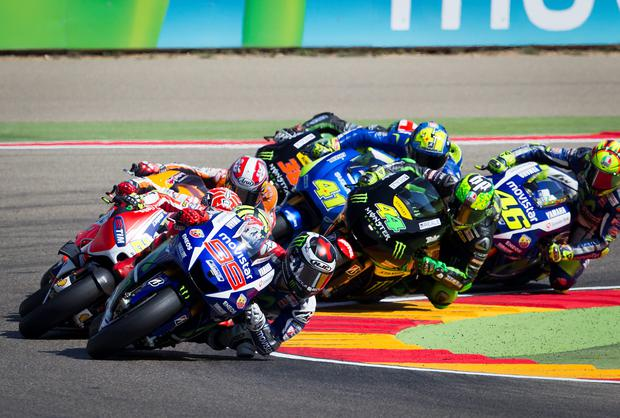 Lean machines: winner Jorge Lorenzo leads the pack into the first curve at Aragon