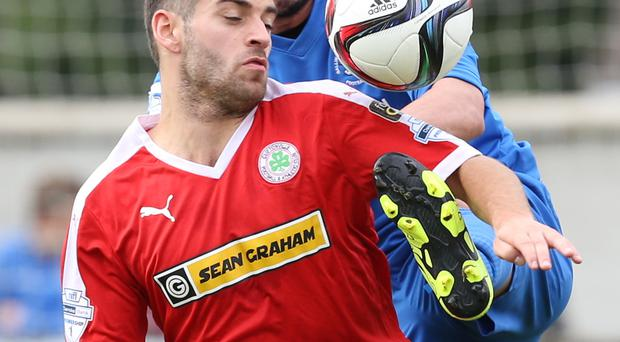 Tight battle: David McDaid of Cliftonville and Emmet Friars