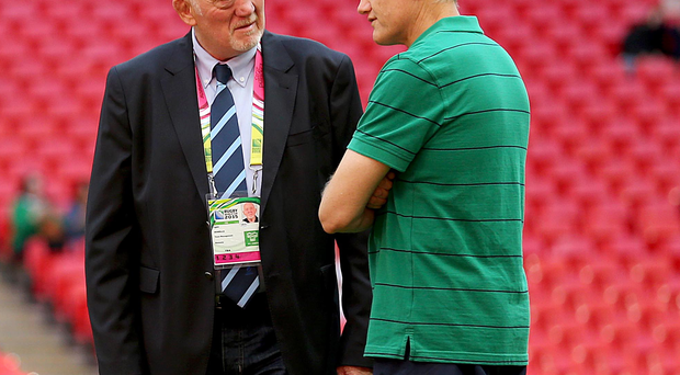 Tete-a-tete: Romania coach Lynn Howells with Joe Schmidt