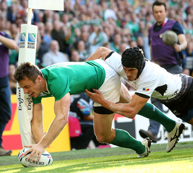 Touching down: Tommy Bowe crosses the whitewash at Wembley for his first try in the 44-10 victory over Romania