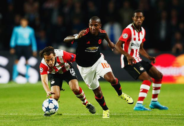 Let down: Ashley Young says Man United are eager to make up for the loss against PSV Eindhoven earlier this month