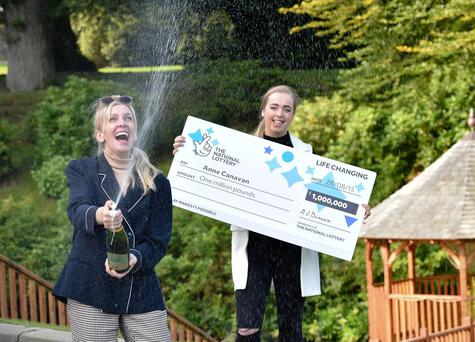 Derry-based inventor Anne Canavan and daughter Cressida celebrate after the mum of four became Northern Irelands latest National Lottery millionaire. PHOTO TAKEN BY SIMON GRAHAM / HARRISON PHOTOGRAPHY.