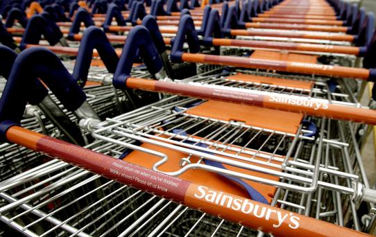 File photo dated 16/01/2006 of trolleys outside a Sainsbury's store in south London. The recovery of the supermarket chain exceeded expectations after the group posted its fifth quarter of sales growth in a row, Wednesday March 29, 2006.