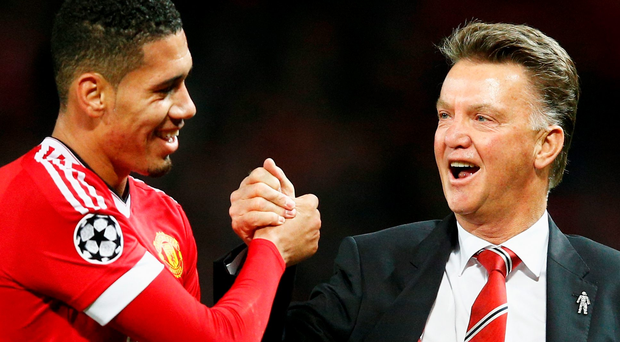 Put it there: United scorer Chris Smalling and boss Louis van Gaal celebrate after last night's match