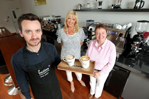 NI Hospice Ambassador, Alison Clarke (C), and representatives of Bailies Coffee get ready for the Big Coffee Break