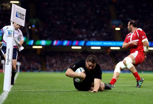 New Zealand's Dane Coles scores his side's fourth try during the Rugby World Cup match at the Millennium Stadium, Cardiff. PRESS ASSOCIATION