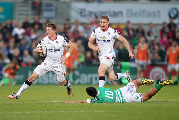 Ulster's Craig Gilroy with Treviso's Sam Christie. Pic: Darren Kidd / Press Eye.