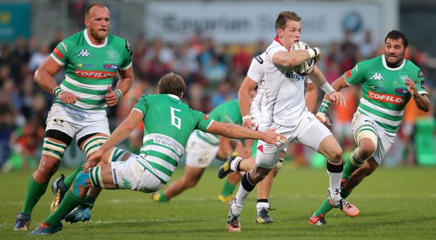 Ulster's Craig Gilroy with Treviso's Marco Barbini. Pic: Darren Kidd / Press Eye.