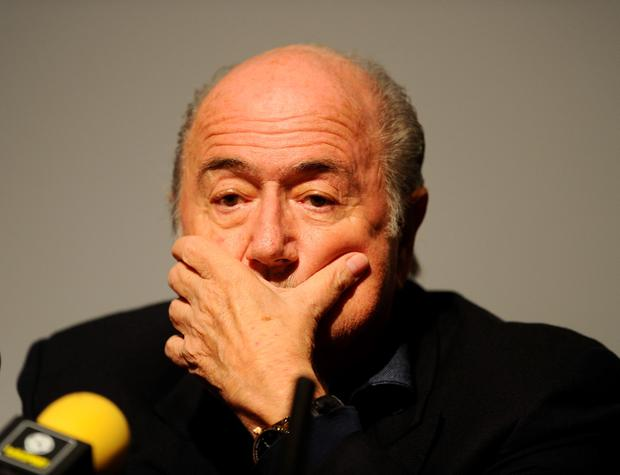 FIFA sponsors Coca-Cola and McDonalds have both issued statements calling for president Sepp Blatter to step down from his post immediately. Adam Davy/PA Wire.