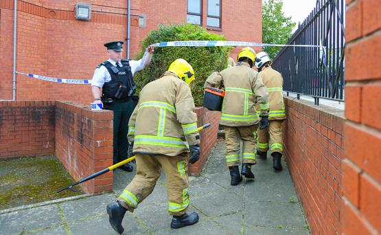 Pictured is police and fire fighters at the scene of an overnight fire that occurred in the Mount area of East Belfast. Picture - Kevin Scott / Presseye