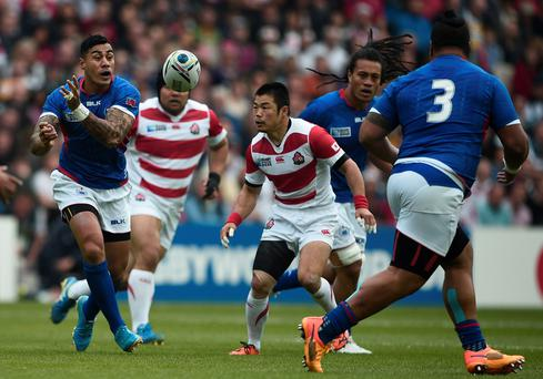 Samoa's fly half Tusi Pisi (L) passes the ball during a Pool B match of the 2015 Rugby World Cup between Samoa and Japan at Stadium MK in Milton Keynes, north of London, on October 3, 2015. AFP PHOTO / DAMIEN MEYER RESTRICTED TO EDITORIAL USE, NO USE IN LIVE MATCH TRACKING SERVICES, TO BE USED AS NON-SEQUENTIAL STILLSDAMIEN MEYER/AFP/Getty Images