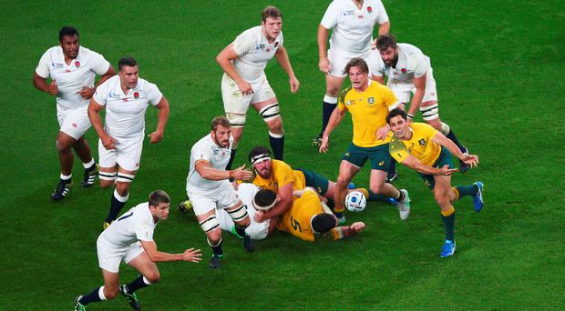 LONDON, ENGLAND - OCTOBER 03: Bernard Foley of Australia releases the ball during the 2015 Rugby World Cup Pool A match between England and Australia at Twickenham Stadium on October 3, 2015 in London, United Kingdom. (Photo by Paul Gilham/Getty Images)
