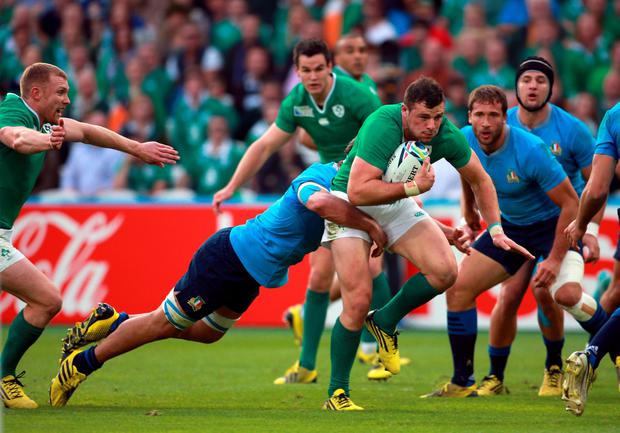 Ireland's Robbie Henshaw gets tackled during the World Cup match at the Olympic Stadium, London. David Davies/PA Wire.
