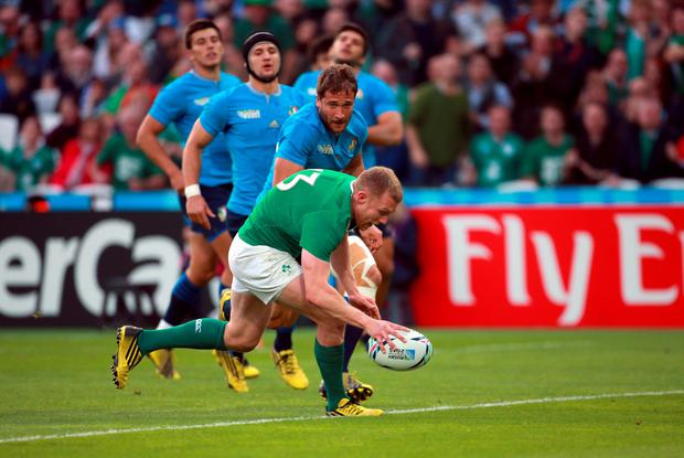 Ireland's Keith Earls scores his side's first try during the World Cup match at the Olympic Stadium, London. David Davies/PA Wire.
