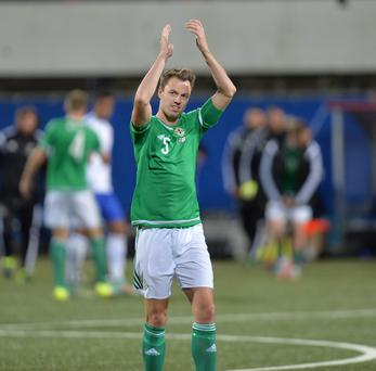 Jonny Evans celebrates the 3-1 victory over the Faroe Islands. during. Pic: Colm Lenaghan/Pacemaker Press.