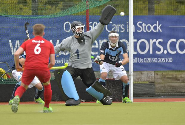 Well saved: Garvey's John Tormey palms out this effort but Monkstown still managed to put five goals past him