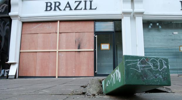 The boarded-up front of Brazil after yesterday's ram-raid